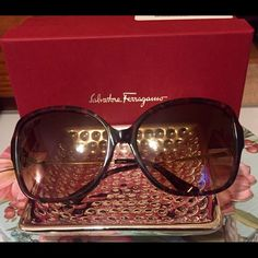 VIP Price: New Ferragamo Sunglasses! Brand new Salvatore Ferragamo sunglasses! Made in Italy❤️ • Bridge Width (mm.): 16,Lens , Width (mm.):59 Lens Width (in.):5.25, Arm Length (mm.):120 .......Pink Havana frames, brown gradient lenses, and gold-tone arms with rhinestone circle on the sides. Comes with case, cleaning cloth, box and cloth bag! Salvatore Ferragamo Accessories Sunglasses