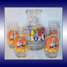 This 5-piece Looney Tunes set includes four (4) 1990 anniversary drinking glasses with Bugs Bunny and his friends and a 1994 Looney Tunes glass carafe decanter.  For sale at Tennessee Antique Shack.  $25.00