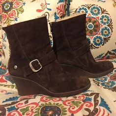 UGG Wedge Ankle Boots Tan UGG wedge ankle boots. I bought these and wore them twice. I bought my usual size but these seem to run a little small. They feel more like a size 8.5. I do not have the original box anymore. UGG Shoes Ankle Boots & Booties
