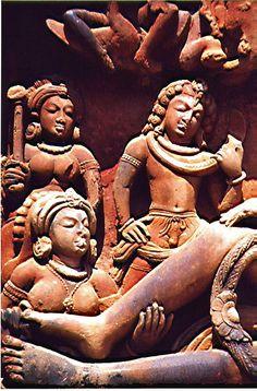 Dashavatara Temple - Carved Panel relief on the doorway of Dashavata Temple depicting Lakshmi flanked by Gada and Chakra ayudhapurushas (personified Vishnu's weapons) tending to Vishnu's feet.