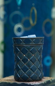 Casbah - Like a carefully crafted mosaic, Casbah features a Mediterranean weave design in rich shades of blue. Vent holes create a distinctive pattern of light.