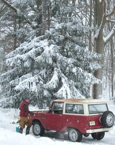 Love this Wintery Scene of a man with his Ford Bronco.