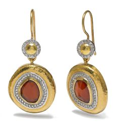Wonderful earrings in 24k gold featuring rubies and diamonds made by GURHAN.