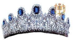 the Meander diamond tiara worn by HIRH Princess Kira of Prussia, born Grand-Duchess of Russia. Made of diamonds mounted in platinum it was designed by Imperial Jeweller Koch and presented by Crown Prince Wilhelm to Crown Princess Cecilie, born Duchess of Mecklenburg-Schwerin, on the occasion of their wedding. HRH Princess Marina, Duchess of Kent, born Princess of Greece and Denmark, wore her most elegant Cambridge Sapphire Parure,
