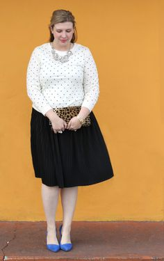Dress up a monochromatic outfit with a pop of color. #curvyfashion J. Crew polka dot tippi sweater, Target black pleated skirt, J. Crew Factory crystal sunburst necklace, Clare V. leopard clutch, Madewell Mira blue suede pumps
