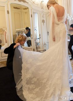 """Alberta Ferretti designed a white chiffon-and-tulle dress with a bias-cut skirt and a plunging back. The slight chiffon drape flutters with movement. """"Candice is tall, slim an ethereal beauty,"""" says Ferretti while she takes a pair of scissors and starts cutting away at the corset. """"I immediately realize that the dress had to underline her lightness."""""""