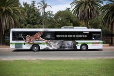 Creative bus ad for a zoo. Looks like the tiger is tearing that bus apart!