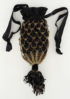 LACMA Collections Online; United States, woman's reticule, c. 1860; bronze beads, silk satin, canaloupe seeds, length: 9 inches
