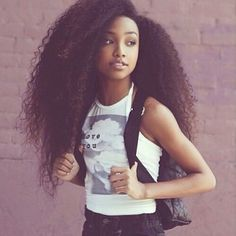 Black girl with big long curly hair. Yea it is very possible!