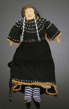 Sioux doll. Muslin body, leather face with beaded features, and horsehair hair.  prices4antiques.com