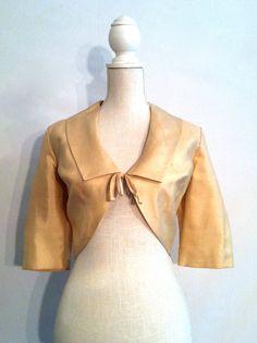 50s Vintage Cropped Cream Jacket / Medium / Large / Bow / High Waisted / 3/4 Length Sleeves. $36.00, via Etsy.