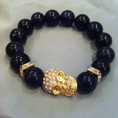Arm Candy Stacked Crystal Gold Skull Bracelet with Blue Sandstone Beads. $4.99, via Etsy.