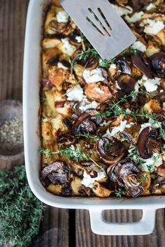 A delicious Baked Egg Casserole called Breakfast Strata with mushrooms, caramelized onions, goat cheese and thyme, perfect for the holidays. Make it ahead!   www.feastingathome.com