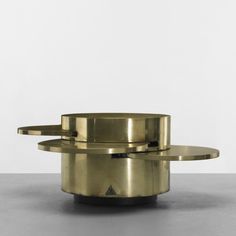 Gabriella Crespi coffee table, Italy, c. 1970, brass, features four retractable shelves