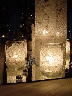 Lace wrapped around a plain glass candle holder. C'est comme les autres, mais il y en a un plus haut.