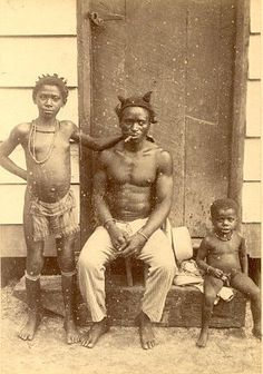 marron [mauritania/meru/mer/meri/morocco] with children | surinam c.1890 [man escaped from transoceanic slave holocaust living with children in the wilderness of the rainforest]