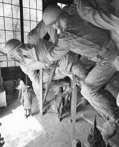 Sculptor Felix de Weldon working on the plaster model of the US Marine Corps War Memorial circa 1954.