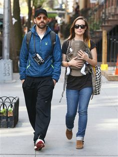 Proud parents Olivia Wilde and Jason Sudeikis take their newborn son Otis out for a stroll in New York on May 1, 2014.