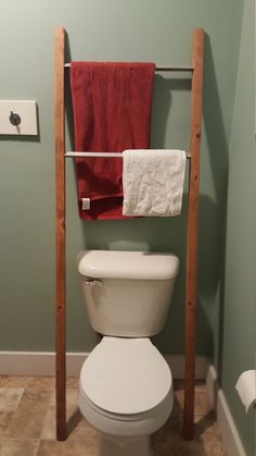 This ladder towel rack over the toilet was used for towel storage
