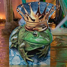 Our Once Upon a Time Frog Prince Standee features a green frog wearing a golden crown on a background of blue water.