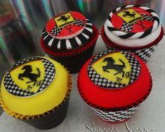 Ferrari - Cupcake FERRARI - Deliciosos Cupcakes decorados em Pasta Americana e papel arroz.Ideal para lembrancinhas. Várias opções de massa, recheio e cobertura. Pedido Mínimo: 20 Unidades ** PODE SER FEITO EM OUTRAS CORES E OUTROS TEMAS ** Retirada ou Entrega: Somente em SP e Grande SP (Consulte-nos sobre Taxa de Entrega) ** SÓ UTILIZAMOS PRODUTOS DE PRIMEIRA LINHA ** R$ 6,00