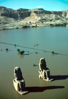 Colossi of Memnon at the Necropolis of Thebes, Egypt, 1965. Photo by Eliot Elisofon. As you can see, the Nile has flooded at the time of this image.(Smithsonian)