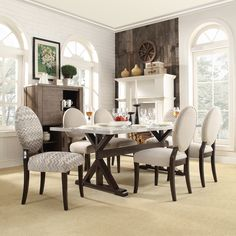 The Trumbull dining set from Inspire Q puts a modern twist on classic style. Six round-back chairs create a stunning visual that perfectly sets off the angular Asian hardwood table base.
