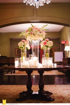 Pale Pink reception with tall blush centerpieces and lots of candlelight #elevatedcenterpiece #candlelitreception