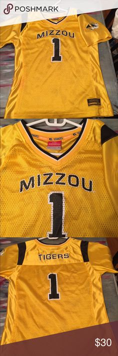 """Mizzou Tigers Mesh Jersey L (Boy) or XS (Wmns) Never been worn. It's a tight-fitting women's or Boy's M/L Gold/Black Mesh with Mizzou emblem on the sleeve. Fits like XS. I'm 5'2"""" 98lbs and it's tight. Colosseum Shirts & Tops Tees - Short Sleeve"""