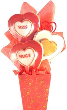 "Looking for a sweet Valentine's Day cookie bouquet that won't break the bank?  Look no further.  We assemble 3 jumbo 3-D sugar cookies measuring approximately 4.5"" x 5"" (1 ""kiss"" heart, 1 ""hugs"" heart, and 1 white with gold heart) into a coordinating gift box, wrap it  with decorative cellophane and top it with a hand tied bow.  A delicious  way to say ""I love you!"" $30 #gift #basket #love #valentine"