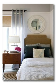 simple easy d.i.y. headboard.  Mirror over bed is great, love the vintage/mid-century nightstand w/ the more mod lamp...colors     are soothing.    Headboard for boys room