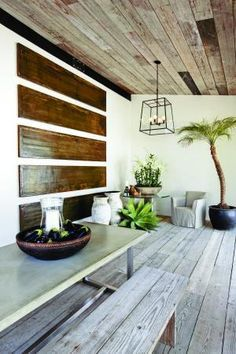 Using cheap wood to jazz up a plain white outdoor wall. Love the plants
