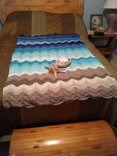 My own work.  Seashore Afghan using Caron Cakes yarn.