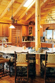 Mike and Mary McClain's log home on Table Rock Lake provides A rustic, relaxing weekend retreat.