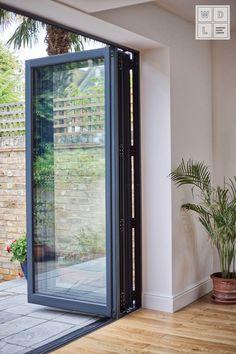 Exceptional Aluminium Bifold door by Windows Doors London. Aluminium Glass Door, Aluminium French Doors, Aluminium Windows And Doors, French Doors Patio, Patio Doors, External Bifold Doors, Modern Windows And Doors, Backyard Door, Sliding Door Window Treatments