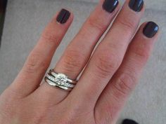 Hand Picture of Brian Gavin's Grace Solitaire and Wedding Bands