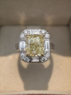 An amazing 3.48ct fancy yellow diamond complemented by baguette & round brilliant cut diamonds. Made by hand in our Melbourne studio.