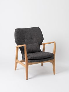 The Fable Oak Armchair is Danish modern inspired furniture design at its finest. With sumptuous padding, and upholstered in hardwearing white/black textured polyester.