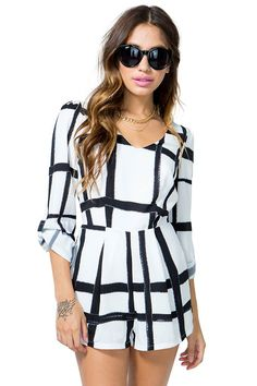 Dress to thrill in this on-trend windowpane romper! Smudgy marker-inspired black and white print. Wide V neck. Diamond-shaped open back with single button closure and zipper at shorts. Button tabbed sleeves.