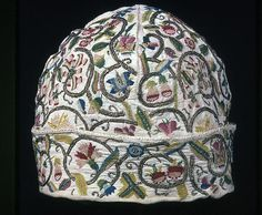 Man's Cap, 1601/25  Linen, plain weave; embroidered with silk floss and gilt-metal-strip-wrapped silk, in variety of buttonhole, chain, long-armed cross, ladder, outline, and running stitches; woven wheels 15.9 x 19.6 x 19.6 cm (6 3/8 x 7 3/4 x 7 3/4 in.) Art Institute of Chicago 1983.742