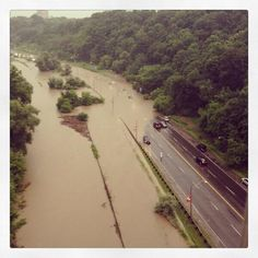 Power outages, submerged cars, flooded subway stations. Photos show parts of Toronto hit by floods after heavy rains Monday, July 8, 2013 - Don Valley Parkway
