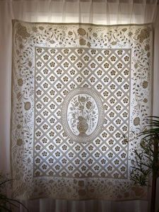 Wow, this is actually a whole-cloth quilt. When draped in front of the window as in this picture, you can see all the trapunto designs. Go to the site and you can also see it on a bed and more details of this gorgeous work.