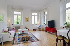 Love scandinavian style - rustic light wood floors, tall ceilings, white walls & trim, bright pieces but white staples.