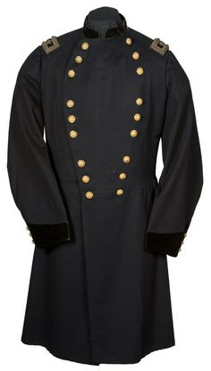 """High quality navy blue double breasted Major General Frock Coat with gilded staff officer's buttons aligned in rows of three set in a distinct """"lyre"""" configuration. Dark navy velvet on collar and non-serviceable cuffs. Buttons are manufactured by Waterbury & Co. Rear of coat has 3 large seams that lead to a center vent. Center vent has 2 buttons at top and middle. Shoulder straps with a dark background and 2 sliver bullion stars with large bullion border and 2 small outlining the large…"""