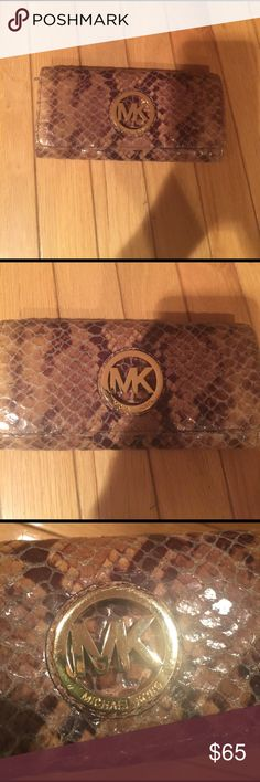 Michael Kors wallet Python Michael Kors wallet. Some cracking on the inside edge of the wallet and light scratches on outside MK gold logo. Light wear and tear as shown in images. Beautiful wallet. Feel free to ask me questions. Michael Kors Bags Wallets