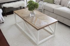 Create a modern farmhouse coffee table with just 2x2s and 1x3s. The top has wood inlay in a herringbone-type pattern, but could be customized with tile, stone, or glass. Dimensions are 4' long x 2' wide x 18