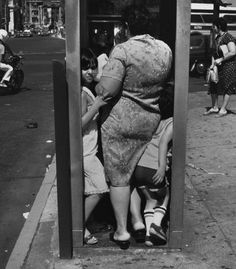 By Helen Levitt. Phone booths gone the way of buggy whips and corsets!