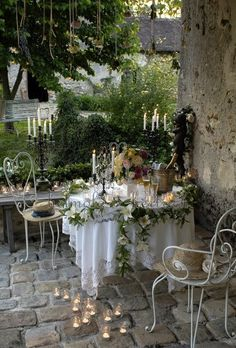Love the delicate lights and subtle, romantic chairs. Perfect for Spring/Summer entertaining!