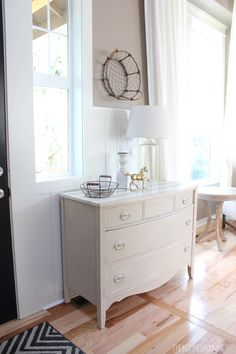 This homeowner placed a dresser in the entry. This is a nice idea. I wouldn't use a flea market find, but likely we have one that could be used.