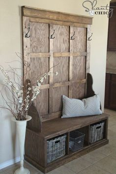Shanty Hall Tree Bench for the Entryway...use the old door from Chuck's old place and build bench from pallets!  Will paint the window part of door with chalkboard paint or maybe install mirror.  Add hooks & baskets under bench.  Yessssss!